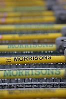 Shopping trolleys' handlebars at a Morrisons super market