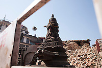 A statue stands alone in the rubble of a destroyed temple Kathmandu Durbar Square, Kathmandu, Nepal. May 03, 2015