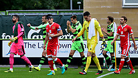 The two teams enter the field of play during Forest Green Rovers vs MK Dons, Caraboa Cup Football at The New Lawn on 8th August 2017