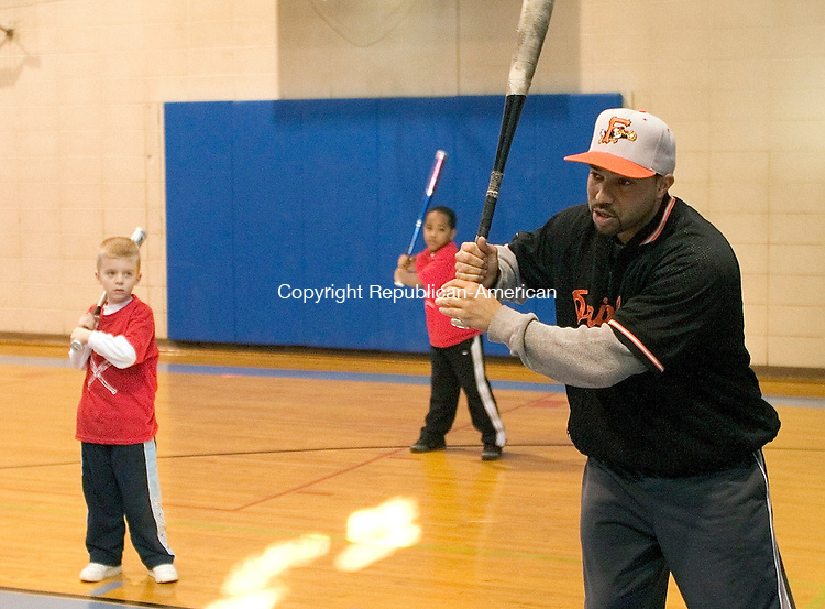 WATERBURY, CT - 07 FEBRUARY 2004 - 020705JS01-- Camp director Jay Maia, right, shows students, including Daniel Nomak, 6 of Prospect and Jermaine Gilbert, 6, of Waterbury the proper batting stance during a baseball camp at the Anderson Boys' Club of Waterbury on Sunday.  --Jim Shannon Photo -- Jermaine Gilbert, Jay Maia, Daniel Nomak, Anderson Boys' Club, Waterbury are CQ