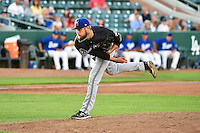 Dallas Newton (29) of the Missoula Osprey delivers a pitch to the plate against the Ogden Raptors in Pioneer League action at Lindquist Field on August 4, 2014 in Ogden, Utah.  (Stephen Smith/Four Seam Images)