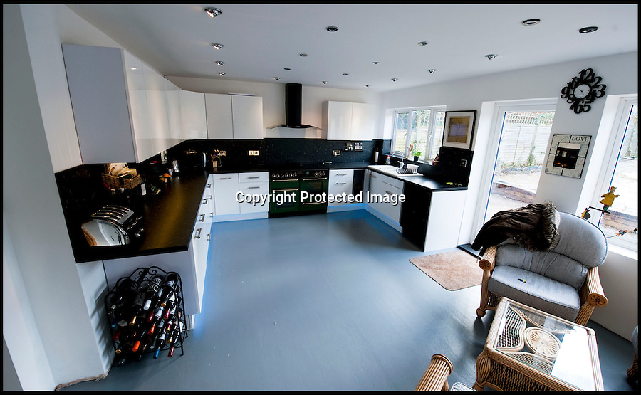 BNPS.co.uk (01202 558833)<br /> Pic: PhilYeomans/BNPS<br /> <br /> Proud Carol's bespoke kitchen.<br /> <br /> Plucky Carol Sullivan turned a £160,000 black hole left by cowboy builders into one million pound house - after building her dream home herself.<br /> <br /> Carol was left severley out of pocket after her luxury home was built with sub-standard mortar - meaning the whole structure had to be pulled down when the project was half way through.<br /> <br /> After firing the builders and waving goodbye to £160,000, undaunted Carol(50) enrolled on a bricklaying course at her local college and learned how to build the house herself. <br /> <br /> Further courses in carpentry and plumbing  have enabled determined Carol to complete the project in a year. The house is now thought to worth £1 million.