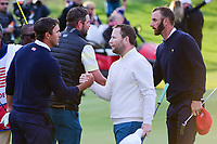 Brooks Koepka (USA) and Brandon Grace (RSA) shake hands following their match during round 3 Four-Ball of the 2017 President's Cup, Liberty National Golf Club, Jersey City, New Jersey, USA. 9/30/2017.<br /> Picture: Golffile | Ken Murray<br /> <br /> All photo usage must carry mandatory copyright credit (&copy; Golffile | Ken Murray)