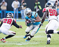 The Carolina Panthers defeated the Atlanta Falcons 34-10 in an inter-division rivalry played in Charlotte, NC at Bank of America Stadium.  Carolina Panthers running back Jonathan Stewart (28), Atlanta Falcons free safety Thomas DeCoud (28), Atlanta Falcons defensive end Stansly Maponga (90)