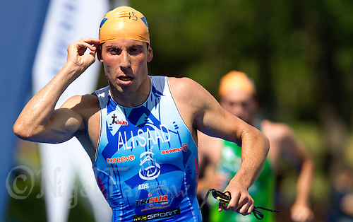 25 MAY 2012 - MADRID, ESP - Samer Ali Saad Guardia (A.D Sevilla Zambru's Bikes) heads for transition at the end of the swim at the Spanish Elite Men's National Standard Distance qualifying race in Casa de Campo, Madrid, Spain (PHOTO (C) 2012 NIGEL FARROW)