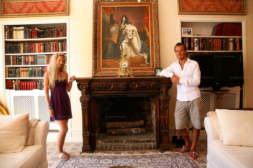 Rune Andersen and Cecile Ruppman, owners of Chateau Robernier, pose in the 'Red Salon' lounge on the ground floor...Chateau Robernier located near Montfort, in the Var, closeby to Provence in southern France. The Chateau dates back to the 16th century with parts added in the 18th and 19th centuries. There is a vineyard attached with 80 hectares of land producing 200,000 bottles of wine per annum. The Chateau, bought in 2007, has been recently renovated by the new owners Mr Rune Andersen, aged 35, owner of several investment companies, including Scan-Tec, and his fiancée Miss Cecile Ruppmann who is Swiss German, aged 29. They both are resident in Monaco.