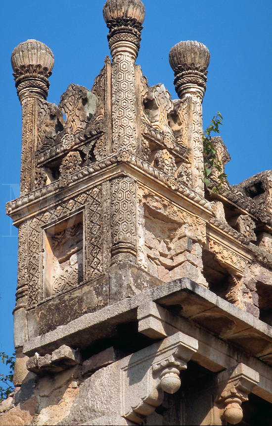 Detail of the elaborate, ornamental exterior of the ruins of the Golconda Fort. Hyderabad, India.