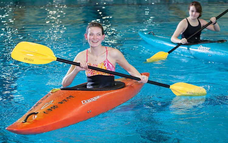 Ohio University Outdoor Recreation and Education major Alex Rhue, orange kayak, poses for a portrait at the Norris Aquatic Center on February 27, 2014. Photo by Lauren Pond