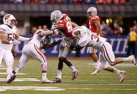 Ohio State Buckeyes wide receiver Corey Smith (84) catches a pass between Wisconsin Badgers linebacker Derek Landisch (30) and cornerback Peniel Jean (21) during the second quarter of the Big Ten Championship game at Lucas Oil Stadium in Indianapolis on Dec. 6, 2014. Smith was ejected from the game later in the quarter. (Adam Cairns / The Columbus Dispatch)