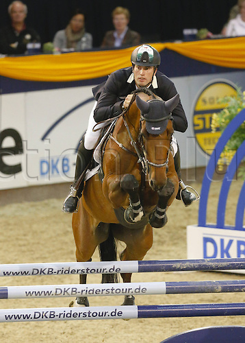 20.10.2013 Hannover Germany.<br /> Gert-Jan Bruggink (NED) and Dejavu in action during The 2013 German Classics International Horse Show