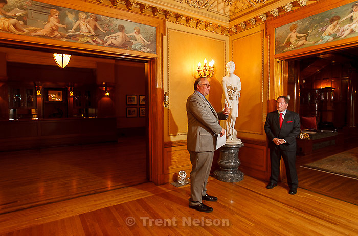 Trent Nelson  |  The Salt Lake Tribune<br /> Mark Magleby, Director of Museum of Art at Brigham Young University and Phil McCarthey speak at the McCune Mansion Tuesday, August 27, 2013 in front of the Blind Girl, sculpted by Giacomo Ginotti (1845-1897). The piece, in addition to another titled Cleopatra, has returned to the McCune Mansion after spending many years at the BYU Museum of Art.
