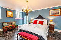 BNPS.co.uk (01202) 558833. <br /> Pic: Strutt&Parker/BNPS<br /> <br /> Bedroom. <br /> <br /> Have Nessie for a neighbour...<br /> <br /> A beautifully-restored 19th century farmstead just minutes from Loch Ness with stunning Highland views is on the market for £675,000.<br /> <br /> The Steading is in the ancient village of Dores and has been lovingly restored and transformed to create a stylish yet cosy home.<br /> <br /> The house is just a few minutes' walk from the beach at Dores and on a clear day from the shore you can see all the way to the opposite end of the iconic loch - 25 miles away at Fort Augustus - which would be a perfect spot to hunt for its famous monster.<br /> <br /> The Steading would be an ideal property for someone looking for a peaceful, rural retreat in the Scottish Highlands, or could be a good investment property to rent out to holidaymakers.