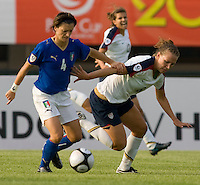 USWNT forward (8) Lauren Cheney is held off by Italy's (4) Alessia Tuttino during the last group stage game at the Peace Queen Cup.  The USWNT defeated Italy, 2-0, at the Suwon Sports Center in Suwon, South Korea.