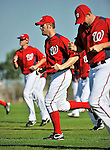 19 February 2011: Washington Nationals' pitcher Stephen Strasburg warms up with running exercises with teammate pitchers prior to working on Spring Training drills at the Carl Barger Baseball Complex in Viera, Florida. Mandatory Credit: Ed Wolfstein Photo