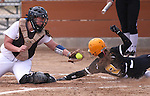 College of Southern Idaho's Amanda Sheets slides safely past the tag of Western Nevada College's Lauren Lesniak during a college softball game at Edmonds Sports Complex in Carson City, Nev., on Friday, Feb. 27, 2015. CSI won the opener 11-2. <br /> Photo by Cathleen Allison/Nevada Photo Source