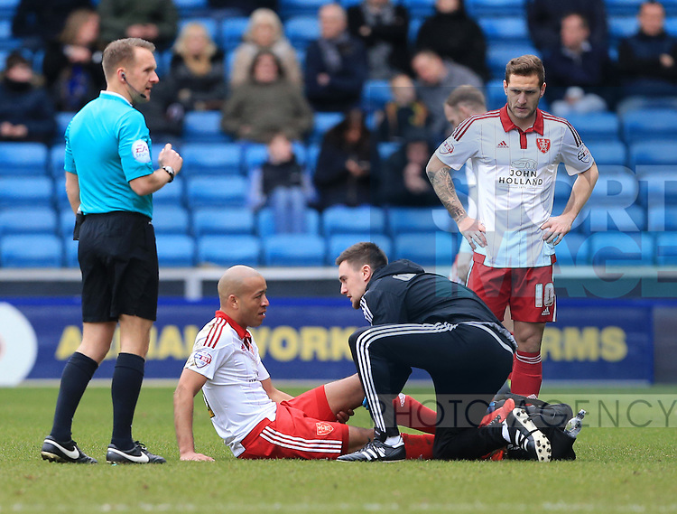 Sheffield United's Alex Baptiste goes off injured during the League One match at The Den.  Photo credit should read: David Klein/Sportimage
