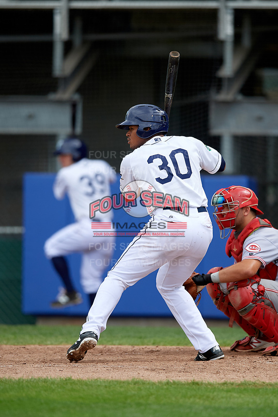 Princeton Rays left fielder Pedro Diaz (30) at bat in front of catcher Hunter Oliver (28) during the first game of a doubleheader against the Greeneville Reds on July 25, 2018 at Hunnicutt Field in Princeton, West Virginia.  Princeton defeated Greeneville 6-4.  (Mike Janes/Four Seam Images)
