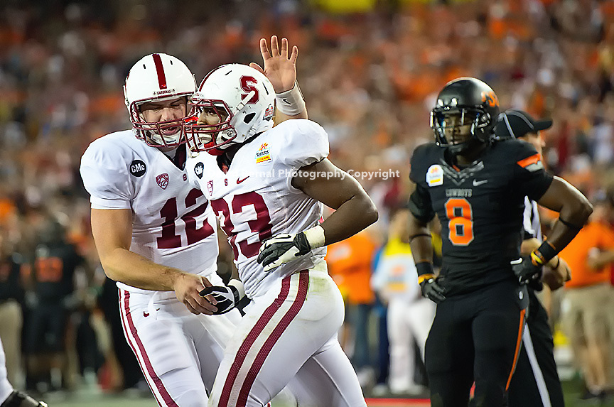 STANFORD, CA - January 2, 2012: Stanford quarterback Andrew Luck (12) congratulates running back Stepfan Taylor (33) on this touchdown against Oklahoma State at the Fiesta Bowl at University of Phoenix Stadium in Phoenix, AZ. Final score Stanford wins 28-14.
