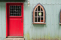 The front door of the converted 19th century chapel is painted a bright red