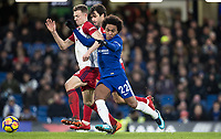 Willian of Chelsea battles Jonny Evans of WBA during the Premier League match between Chelsea and West Bromwich Albion at Stamford Bridge, London, England on 12 February 2018. Photo by Andy Rowland.