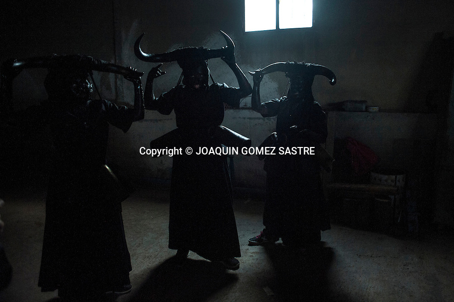 Devils Luzon (Guadalajara) dress in a garage before leaving to walk the streets