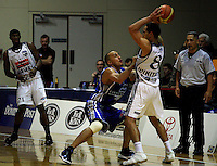 Brendon Polybank tries to block Paora Winitana as Kevin Smith looks on during the NBL Basketball match between the Wellington Saints and Bay Hawks, TSB Bank Arena, Wellington, New Zealand on Saturday, 10 May 2008. Photo: Dave Lintott / lintottphoto.co.nz
