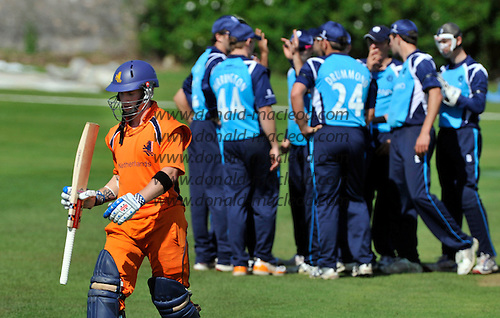 Cricket One Day International - Scotland V The Netherlands at Mannofield - Aberdeen - Netherlands batsman Alexei Kervazee walks to the pavilion after being caught Davey bowled Haq for 49 - Picture by Donald MacLeod - 28.6.11 - 07702 319 738 - www.donald-macleod.com