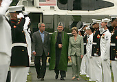 Camp David, MD - August 5, 2007 -- United States President George W. Bush and first lady Laura Bush greet President Hamid Karzai of Afghanistan at Camp David, Maryland on Sunday, August 5, 2007.  .Credit: Dennis Brack - Pool via CNP