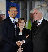 "United States President Barack Obama and former U.S. President Bill Clinton tour a ""trophy"" office building at 815 Connecticut Avenue, NW, and will speak later about job creation and energy efficiency Friday, December 2, 2011 in Washington, DC.  Obama has recruited Clinton and major corporations including 3M Co. and Alcoa Inc. in a $4 billion initiative to cut energy costs in buildings and encourage hiring for construction jobs.  To date, the energy efficiency measures in this building that have been completed are saving almost $200,000 per year, or over $0.99 per square foot. Randi Weingarten, president of the American Federation of Teachers, is at center..Credit: Olivier Douliery / Pool via CNP"
