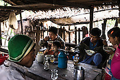 Villagers eat breakfast at a local restaurant in Kwin Sekhan Village in Pyapon district of Myanmar.
