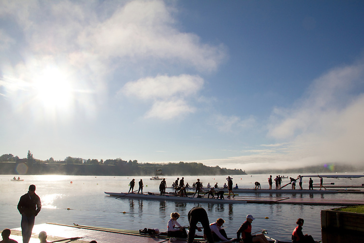 Rowing, Fog, Rowers, Launching racing shells; 2010 FISA World Rowing Championships; Lake Karapiro; Hamilton; New Zealand; November 4, 2010;