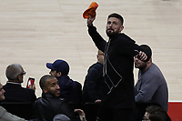 17th January 2019, The O2 Arena, London, England; NBA London Game, Washington Wizards versus New York Knicks; Olivier Giroud of Chelsea joins in the fan appreciation during a time out and throws shirts into the crowd
