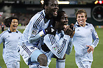 10 March 2012: Kansas City's C.J. Sapong (center) celebrates scoring the game's only goal with Kei Kamara (SLE) (above), Roger Espinoza (HON) (left), and Matt Besler (right). Sporting Kansas City defeated DC United 1-0 at RFK Stadium in Washington, DC in a 2012 regular season Major League Soccer game.