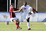 09 November 2010: NC State's John Lung'aho (21) is defended by Virginia Tech's Albert Alwang (left). The North Carolina State University Wolfpack defeated the Virginia Tech Hokies 6-3 at Koka Booth Stadium at WakeMed Soccer Park in Cary, North Carolina in the ACC Men's Soccer Tournament Play-In game.