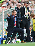 Csaba Laszlo explodes with rage as Tony Mowbray looks on