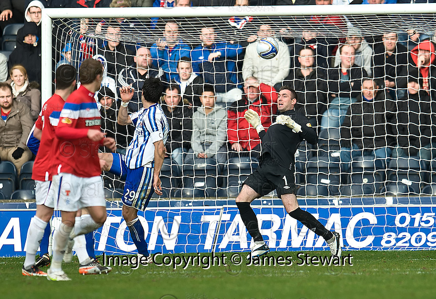 KILMARNOCK'S MANUEL PASCALI HEADS THE BALL OVER RANGERS' ALLAN MCGREGOR FOR KILLIE'S WINNING GOAL