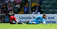 Lincoln City's Josh Vickers saves at close range from Swindon Town's Jermaine McGlashan<br /> <br /> Photographer Chris Vaughan/CameraSport<br /> <br /> The EFL Sky Bet League Two - Lincoln City v Swindon Town - Saturday 11th August 2018 - Sincil Bank - Lincoln<br /> <br /> World Copyright &copy; 2018 CameraSport. All rights reserved. 43 Linden Ave. Countesthorpe. Leicester. England. LE8 5PG - Tel: +44 (0) 116 277 4147 - admin@camerasport.com - www.camerasport.com