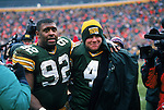 Green Bay Packers efensive end Reggie White (92) and quarterback Brett Favre (4) celebrate after an NFL football game against the Chicago Bears at Lambeau Field on November 12, 1995 in Green Bay, Wisconsin.  The Packers won 35-28. (Photo by David Stluka)