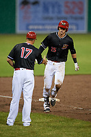 Batavia Muckdogs first baseman Sean Reynolds (25) is congratulated by manager Mike Jacobs (17) as he rounds third base after hitting a home run in the bottom of the seventh inning during a game against the Williamsport Crosscutters on June 22, 2018 at Dwyer Stadium in Batavia, New York.  Williamsport defeated Batavia 9-7.  (Mike Janes/Four Seam Images)