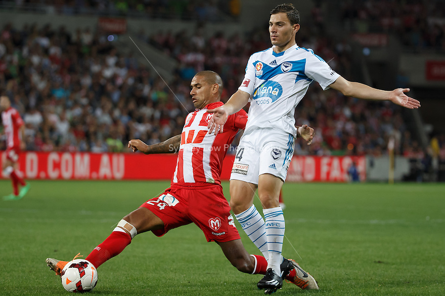 Patrick KISNORBO of the Heart and James TROISI of the Victory compete for the ball in the round 21 match between Melbourne Heart and Melbourne Victory in the Australian Hyundai A-League 2013-24 season at AAMI Park, Melbourne, Australia. Photo Sydney Low/Zumapress<br /> <br /> This image is not for sale on this web site. Please visit zumapress.com for licensing