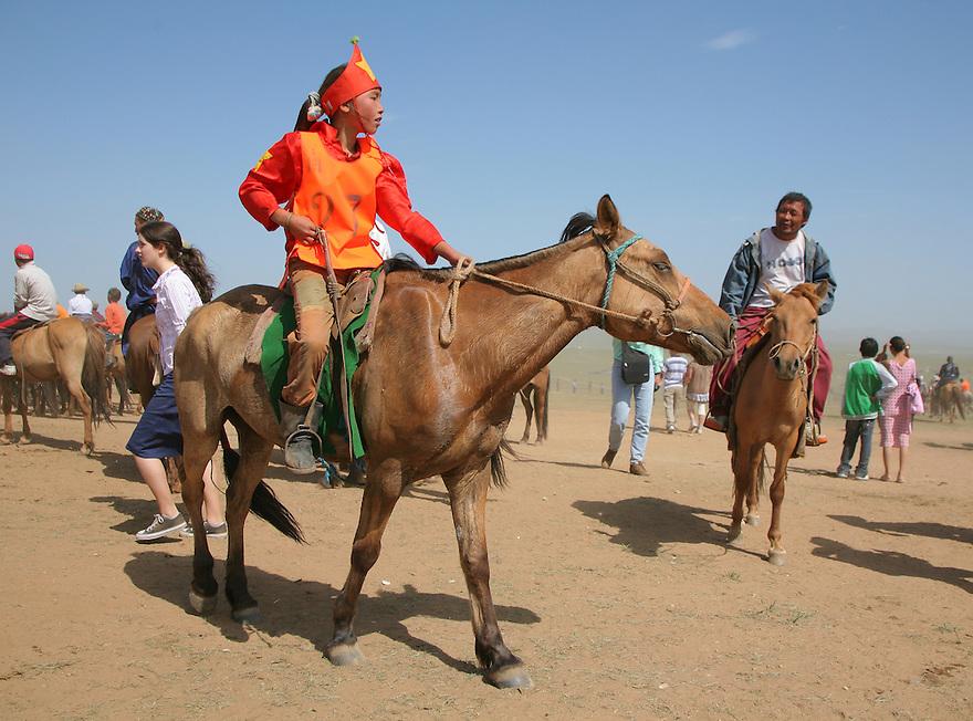 Child riding horse at Naadam Festival Mongolia