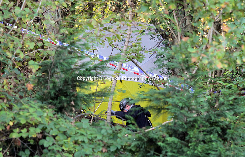 NO BYLINE PLEASE<br /> Pictured: Specialist Search Unit officers at the scene where the body of 15 year old Rebecca Aylward was discovered. Monday 25 October 2010<br /> Re: South Wales Police are investigating the murder of 15 year old Rebecca Aylward from Maesteg in south Wales. Her body was discovered in woodlands outside Aberkenfig near Bridgend. Two fifteen year old men have been arrested.