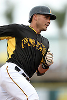 Catcher Tony Sanchez (26) of the Pittsburgh Pirates runs the bases after hitting a home run during a spring training game against the New York Yankees on February 26, 2014 at McKechnie Field in Bradenton, Florida.  Pittsburgh defeated New York 6-5.  (Mike Janes/Four Seam Images)