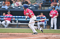Asheville Tourists second baseman Forrest Wall (7) lays down bunt during a game against the Rome Braves on May 15, 2015 in Asheville, North Carolina. The Braves defeated the Tourists 6-0. (Tony Farlow/Four Seam Images)