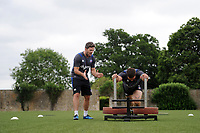 Matt Banahan of Bath Rugby in action as team-mate Darren Allinson shouts encouragement. Bath Rugby pre-season S&C session on June 22, 2017 at Farleigh House in Bath, England. Photo by: Patrick Khachfe / Onside Images