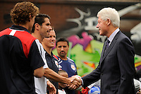 Former President Bill Clinton shakes hands with Juan Pablo Angel of the New York Red Bulls prior to a press conference announcing former President Bill Clinton as the honorary chairman of the USA Bid Committee to host the FIFIA World Cup in 2018 or 2022 at the FC Harlem Field in Harlem, NY, on May 17, 2010.