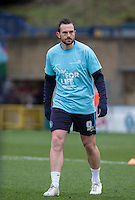 Paul Hayes of Wycombe Wanderers warms up in his NHS Sign for Life shirt during the Sky Bet League 2 match between Wycombe Wanderers and Bristol Rovers at Adams Park, High Wycombe, England on 27 February 2016. Photo by Andy Rowland.
