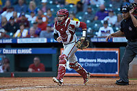 Arkansas Razorbacks catcher Casey Opitz (12) on defense against the Oklahoma Sooners in game two of the 2020 Shriners Hospitals for Children College Classic at Minute Maid Park on February 28, 2020 in Houston, Texas. The Sooners defeated the Razorbacks 6-3. (Brian Westerholt/Four Seam Images)