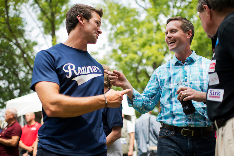 UNITED STATES - AUGUST 14: Reps. Rodney Davis, R-Ill., right, and Aaron Schock, R-Ill., attend Republican Day at the Illinois State Fair in Springfield, Ill., August 14, 2014. (Photo By Tom Williams/CQ Roll Call)