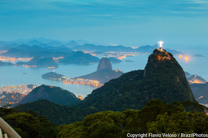 Christ the Redeemer statue and Sugar Loaf Mountain in background, two of the most international known Brazil landmarks.